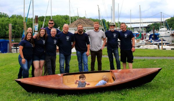 Our members standing next to a one of the kayaks they built this year.